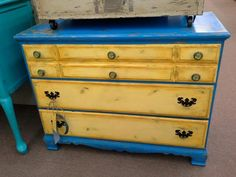 $215 - This is a blue and yellow 3 drawer chest with world map knobs on the top drawer. Painted and heavily distressed.  Measuring 42 inches across the front and 18 inches deep. Standing 32 inches tall. It can be seen in booth D 11 at Main Street Antique Mall 7260 East Main St ( E of Power Rd ) Mesa 85207 480 9241122 open 7 days 10 till 530 Cash or charge 30 day layaway also available