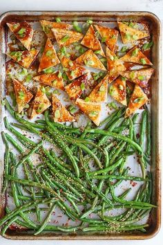 Simple Sheet Pan Sesame Tofu and Green Beans Recipe. Sheet pan dinners and suppers are the ultimate in one pan recipes. This quick and EASY dish is great for a weeknight meal or a sunday supper with your family. This Asian inspired dinner features extra f Green Bean Recipes, Veggie Recipes, Whole Food Recipes, Vegetarian Recipes, Cooking Recipes, Healthy Recipes, Firm Tofu Recipes, Healthy Snacks, Simple Tofu Recipes