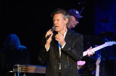 "Update at 5:45 p.m.: Baylor has issued a brief statement that says Randy Travis has been under ""heavy sedation"" since Wednesday night's surgery. He ""is resting comfortably,"" says the statement."