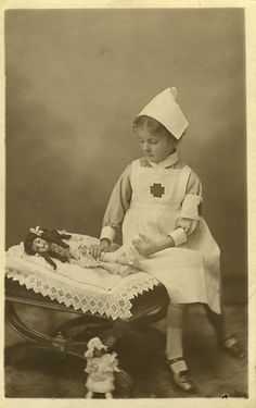 Playing at her own doll hospital, Nurse with dolls, a smaller doll on the floor…