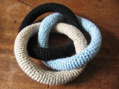 How to make crocheted Borromean rings. maybe insert beans in the tubing and make a baby rattle?