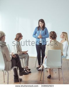 Young woman feeling stressed during public appearance