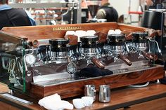 La Marzocco. This is a must have in my life at some time. a single group would be just fine.