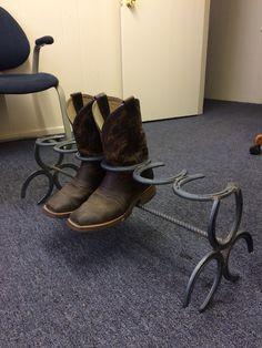 Horseshoe boot rack.