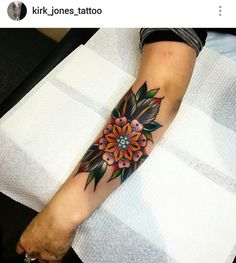 American traditional flower tattoo by Kirk Jones