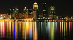 Stock video footage This is the Ohio River across from Louisville Kentucky.  The river flows gently by in this subtle tilt shift shot of the city and the lights in the river.  Every Color of the ...