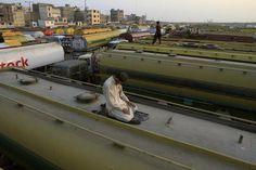A truck driver performed evening prayers atop an oil tanker in Karachi, Pakistan, Wednesday [December 7, 2011]. (© Shakil Adil/Associated Press)
