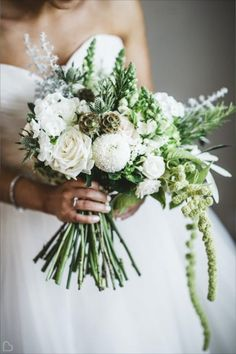 Gorgeous white flower bouquet by Campbell's Flowers based in South Yorkshire, UK. They love British grown flowers designed in a romantic luxe style. Wedding flowers - white, bouquet, winter, UK