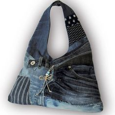 One-of-a-kind. Convenient and stylish. Pretty cool recycled jeans patchwork hobo bag. A bag is made from Japanese old splashed pattern hand-dye indigo fabric & old jeans. Fully lined with pockets x 5: 2 x inside, 3 x outside. Magnetic snap top closure. Shoulder strap: 25 Zipper slider: braid