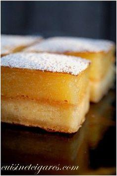 Petit Carré(ment) gourmand au Citron (125 g de beurre - 40 g de sucre glace -150 g de farine – sel - 3 œufs - 220 g de sucre - 35 g de farine - 12 cl de jus de citron - zeste d'1/2 citron)