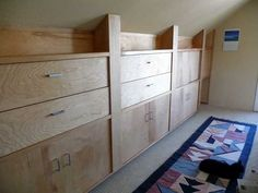 LTwenty foot long by five foot high custom knee-wall cabinet. Includes four large file drawers, panel door shelving units, large pull outstorage compartments along bottom of cabinet(s). Also...