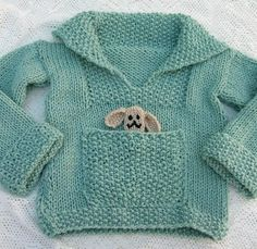 Free Knitting Pattern for Easy Pudding Pie Baby Sweater - Easy pullover baby sweater with pocket in stockinette and seed stitch. Sizes Chest: (22) 26 inches . Note: the toy is not included in the knitting pattern. Also note that this pattern is on the Internet Archive.