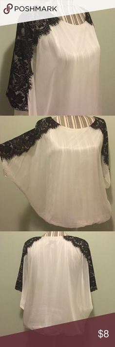 """J.R. NITES Fancy top! 🌟FLASH SALE🌟 Very cute on. Can fit medium/large. Size 8. 100% polyester. Spot clean only. Soft chiffon material with lace detail on the sleeves. Elastic at the bottom. Preloved but in good condition. Slight discoloring at neckline and tag has been """"blacked out"""" last picture shows this. Reasonable offers considered. J.R.NITES by Carol Lin Tops"""