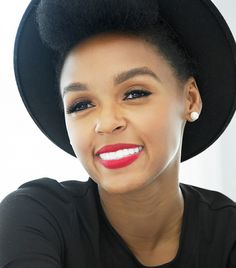 Janelle Monae rocks bright red, matte lips.