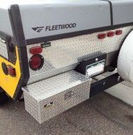 Gain Extra Space with a RV Tool Box Mounted to the Rear Bumper. Looking for a nice dry place to store some of those non-essential items? Who decides what is non-essential is a different story all together, but here is a great mod for adding a tool/storage box to the bumper of a RV.