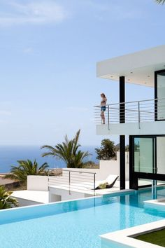 Modern home in Ibiza with clear, fresh blue pool surrounded by white tiles, truly keeping in line with geometric linear style of home... #modernpoolhotel