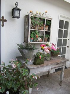 pretty porch table and shelf made from an old window and boards