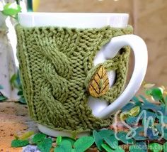 Check out this cabled mug cozy Simply Notable knit with Cotton-Ease.