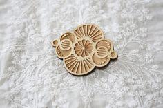 laser engraved flower geometric brooch