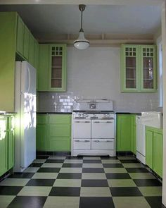 floor decoration with black and white checker board pattern, light green kitchen cabinets