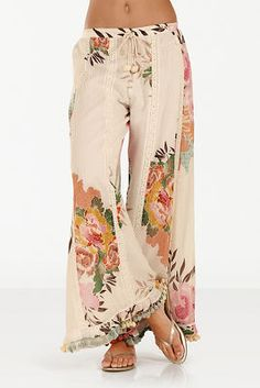 Pack this palazzo pant now for your offshore cruise excursion. Detailed with a beautiful tropical floral print, peek-a-boo embroidery and a pom-pom hemline, you are going to l