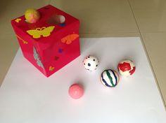 Clasificación por tamaño, elaborada con una caja para regalo y pelotas de unicel.