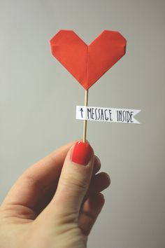 DIY Paper Heart Decoration | Write a little love note on the paper before folding it!