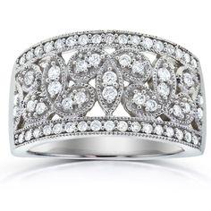 <li>Wide diamond ring</li> <li>14-karat white gold jewelry</li> <li> <a href='http://www.overstock.com/downloads/pdf/2010_RingSizing.pdf'><span class='links'>Click here for ring sizing guide</span></a></li>