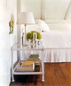Offer guests a carafe of water, a good reading light and books on the bedside table to make them feel at home. Download guest room checklists at onekingslane.com/holiday