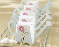 Watering Can Gift Box: Emily recently had her 6th birthday and we had a flower garden theme party for her.  I loved the free candy stripe party decorations from Fun Stuff To