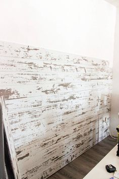 A wood plank wall can add a rustic focal point to a room. It's an easy DIY project. We have the step-by-step tutorial using prepared wood planks.