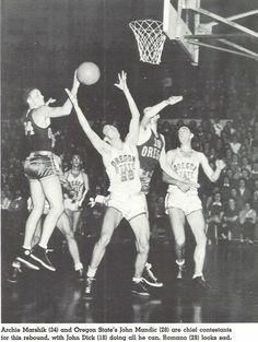 1939-40 UO varsity basketball civil war game at Mac Court Oregon State vs. Oregon. John Dick and Archie Marshik near the rim.  From the 1940 Oregana (University of Oregon yearbook).  www.CampusAttic.com
