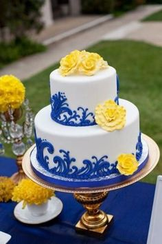 blue and yellow wedding cakes | Wedding cake with blue accents and yellow flowers. Love!