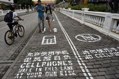 A stretch of sidewalk at a popular tourist destination in Chongqing, China, was designated for...