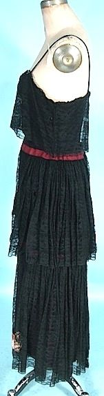 "c. 1930's Black Net with Floral Appliques 3-piece Outfit! Hooded Coat, Camisole and Skirt. The material and the appliques at certainly from the 1930's... even the black lace on the inner balloon sleeves and the coat hood are 1930s. However you would expect to see a gown under this hooded coat, but instead it's a 2-piece ""dress""... with camisole top (with scalloped hemline of silk) and an ""elastic"" waist tiered lace skirt. Dress sideway"
