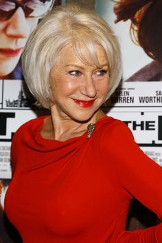 Helen Mirren Lookbook: Helen Mirren wearing Michael Kors Cocktail Dress (10 of 25). Helen Mirren was red hot at the premiere of 'The Debt' in a Michael Kors dress. The ruched detailing and brooch embellishments complemented the demure ensemble.