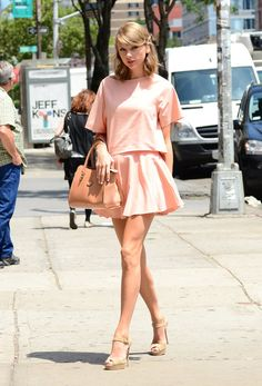 Taylor Swift street style: Taylor's peachy pairing felt ultra-feminine thanks to her girly accessories.