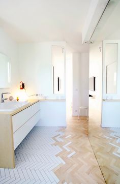 Bathroom statement tile floor covering wet area transitioning to wood