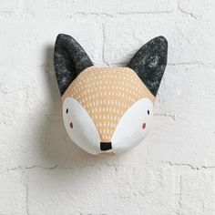 Shop Paper Mache Fox Head. Spruce up your walls with some delightful woodland friends. This fox wall décor is hand-painted and adorned with intricate details, making them each a one-of-a-kind piece of art. Group Forest Pop Wall Decor together for a charming troupe you won't find in the wild.