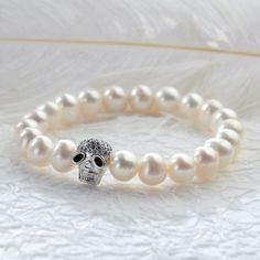 Unique Skull Bead Freshwater Pearl Single Strand Bracelet Halloween Bracelet for Girls Gift Jewelry. We offer different kinds of jewelry, such as pearl jewelry, silver jewelry, stone jewelry, shell jewelry etc wholesale. Shell Jewelry, Pearl Jewelry, Stone Jewelry, Beaded Jewelry, Pearl Bracelets, Cleaning Silver Jewelry, Freshwater Pearl Bracelet, Beaded Skull, Strand Bracelet