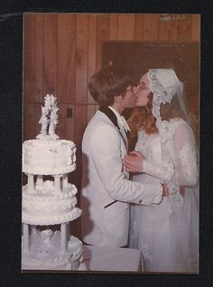 Vintage Photograph Bride and Groom Kissing By Wedding Cake 1975