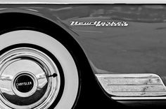 1950 Chrysler New Yorker Coupe Wheel Emblem - Chrysler Photographs by Jill Reger