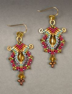 """Silk Road"" earrings in gold, turquoise, green, and fuchsia, with glass beads. Gold-filled ear wires. Approx. 2.5"" Long. Price $95"