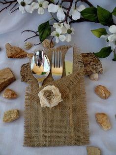 This listing is for 25 handmade Natural Burlap Silverware holders decorated with fabric flower.    Bring with these elegant burlap silverware holders the rustic feel to your table!    Dimensions: 8 inches high by 4 inches wide.    Please pick from the photos a style of bags which you prefer.    Contact me for orders over 25 for a DISCOUNT All the products are handmade in my smoke-free and pet-free home.