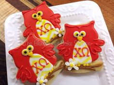 Cardinal and straw owl cookies with white carnations from the Bluebonnet Bake Shoppe.