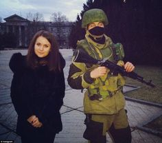 Sweetest guys: This woman posted a photograph of herself on Instagram next to this Russian soldier carrying a gun but said he was very sweet