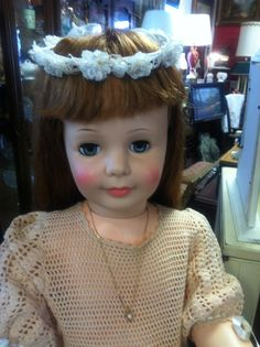 New lashes, cleaned up and a new antique dress ! What more could a doll want !