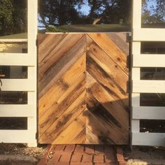 Reclaimed fence wood with vintage bed frame for the steel base