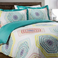 Add a fun print to the bedroom with the stylized multi-blossoms pattern on this lovely duvet cover set. It brings a bright lightness to any room with its wispy and warm cotton.