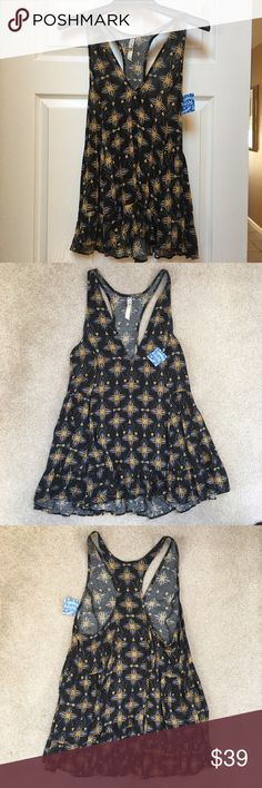Free People Flowy Tank New with tags Intimately Free People flowy, loose fitting tank top. Size Small. Crossback Ruffed hem. Gold, blue and white floral design on black background. From smoke-free, pet-free home. Free People Tops Tank Tops
